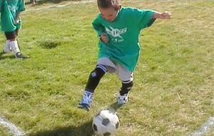 Fútbol y los deportes por equipos para niños
